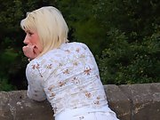 Exhibitionist blonde babe in naughty outdoor pantyhose fashion show