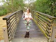 BBW Celeste in a camo jumpsuit flashing her tattooed pierced nipples